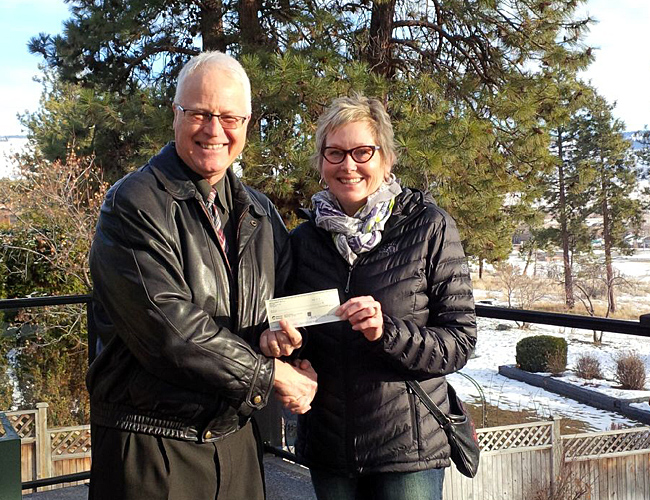 David Brown from the Merritt Sunrise Rotary Club in Merritt, BC presents club director Shelley Cressy-Hassel from the Nicola Nordic Ski Club, Merritt B.C. with a $500.00 cheque to help with the 2015-2016 Nicola Nordic Cross Country Ski season.