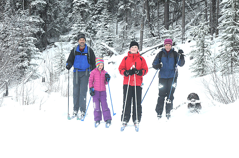 The Parno family enjoy a day of skiing with their pooch. Mathews loop is the only trail on which dogs are allowed.