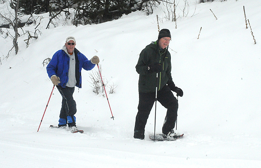 Maurice and Terry snowshoeing in Kane Valley. Snowshoers are asked to stay off the groomed trails but there are some marked trails for snowshoeing - check out our home page.